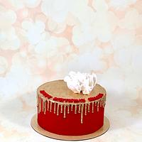 Red and gold drip cake