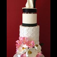 Pink orchids and magnolias wedding cake
