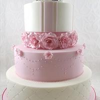 Pink Wedding cake with custom topper