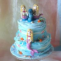 Mermaids with dolphin
