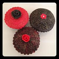 Black and red embossed cupcakes.