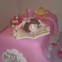 Girl on a bed cake by suzanne Mailey