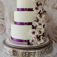 Purple butterflies and rose wedding cake