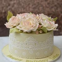 Pale yellow cake with sugar roses