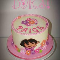 Dora buttercream cake with fondant accents