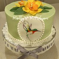 Hummingbird and daffodils