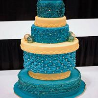 teal and gold wedding cake