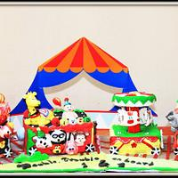 Circus carnival cake with a rotating carousel