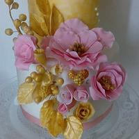 Vintage pink and gold wedding cake