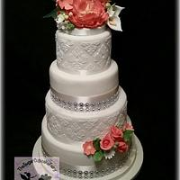 An Ivory and Coral Damask Wedding Cake