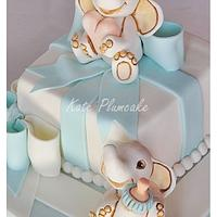 Christening cake with baby elephants