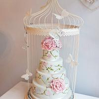 Love birds hand painted cake in bird cage cake stand