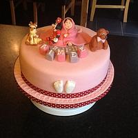 Baby in blanket with Minnie Mouse Christening cake