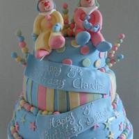 Fab funky clowns birthday cake by Jo's Cakes