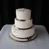 White and Browm Wedding Cake by Cynthia Jones