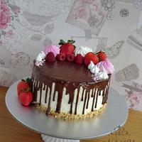 Chocolate drip and meringue cake