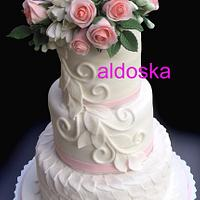 Wedding cake with freesia and roses