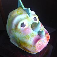 dinosaur head sculptured cake