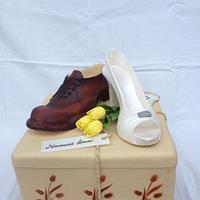 Unusual wedding cake with shoes