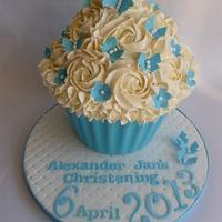 Christening giant cupcake by SweetDelightsbyIffat