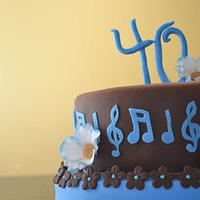 Brown and blue 40th birthday cake  by Cakesbylala