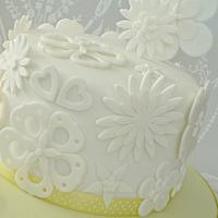 White cut out flower cake