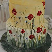 Painting cake with poppies