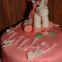 A smal Unicorn cake and 30 cake pops