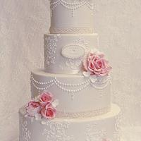 Lace and pearl wedding cake.