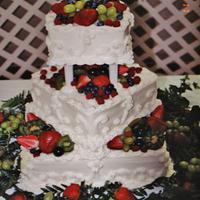 Square wedding cake with fresh fruit