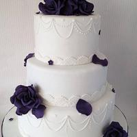 Purple roses with swags