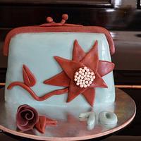 clutch bag cake by giveandcake