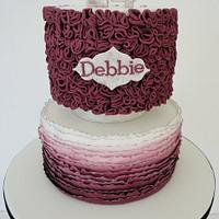 vintage style Ombre ruffle cake in dusky pink with brushed silver detaling