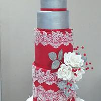 Wedding cake in red, silver and pearls