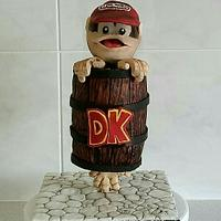 Gravity defying Diddy Kong stuck in a DK barrel cake.