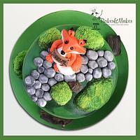 A fox feeding birthday cake!