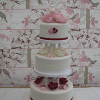 Wedding Cake with pink, cream and burgundy roses & peonies