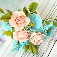 Shades of blue and coral- Free formed Austin Roses and Himalayan Blue Poppy