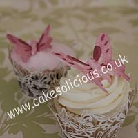 Butterfly wedding cake and cupcakes