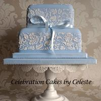 Pale blue wedding cake with stencilled 'Peony' design