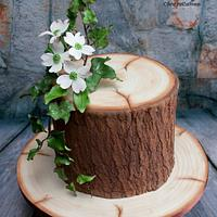 Realistic Wood Effect cake with sugarpaste Ivy & Dogwood flowers