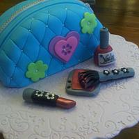 Makeup bag cake with edible makeup