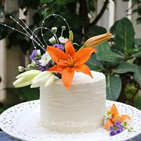 Rustic White chocolate  cake with fresh flowers !