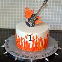 Flames/guitar first birthday cake