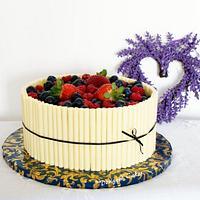 Cake with white chocolate cigarellos