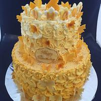 Yellow ombré cake with edible butterflies