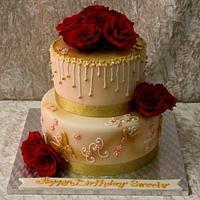 Golden cake with red roses