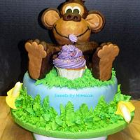 Monkey Sneaks a Taste on a First Birthday