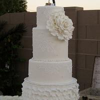 Vintage style wedding cake with ruffles and lace