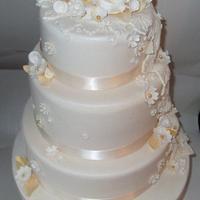 Cream and gold wedding cake